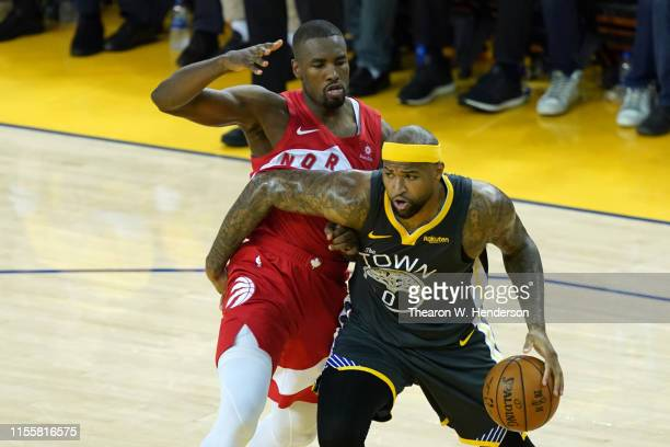 DeMarcus Cousins of the Golden State Warriors is defended by Serge Ibaka of the Toronto Raptors in the second half during Game Six of the 2019 NBA...