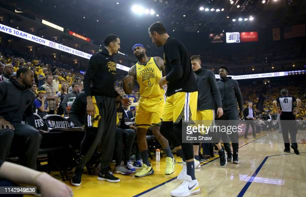 DeMarcus Cousins of the Golden State Warriors is helped off the court after injuring himself against the LA Clippers during Game Two of the first...