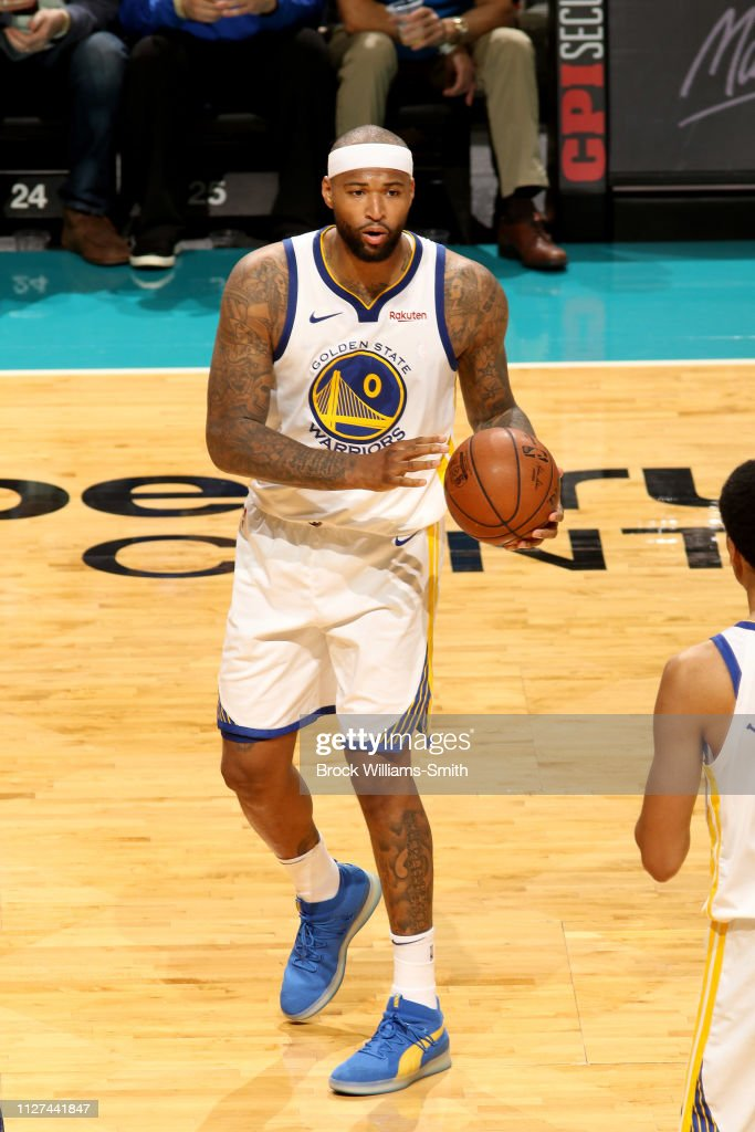 7e78e18ce DeMarcus Cousins of the Golden State Warriors looks to pass the ball ...
