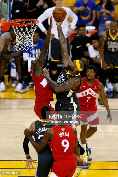 DeMarcus Cousins of the Golden State Warriors scores a basket against the Toronto Raptors against the Toronto Raptors in the second half during Game...