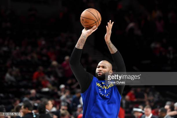 DeMarcus Cousins of the Golden State Warriors warms up before game three of the NBA Western Conference Finals against the Portland Trail Blazers at...