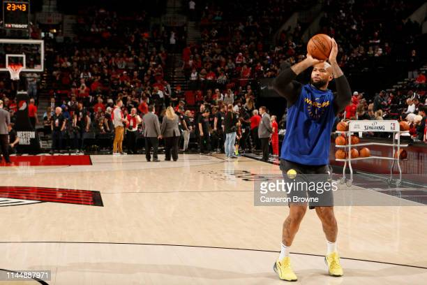 DeMarcus Cousins of the Golden State Warriors warms up before the game against the Portland Trail Blazers during Game Three of the Western Conference...