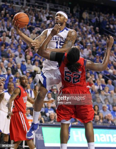 DeMarcus Cousins of the Kentucky Wildcats shoots the ball while defended by DeAundre Cranston of the Ole Miss Rebels during the SEC game on February...