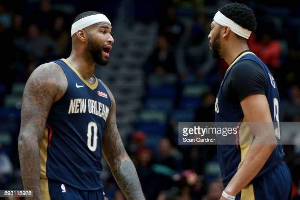 DeMarcus Cousins of the New Orleans Pelicans and Anthony Davis of the New Orleans Pelicans stand on the court during the second half of a NBA game at...