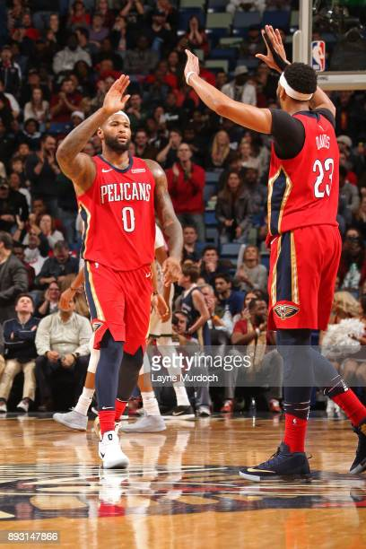 DeMarcus Cousins of the New Orleans Pelicans and Anthony Davis of the New Orleans Pelicans react to a play during the game against the Milwaukee...