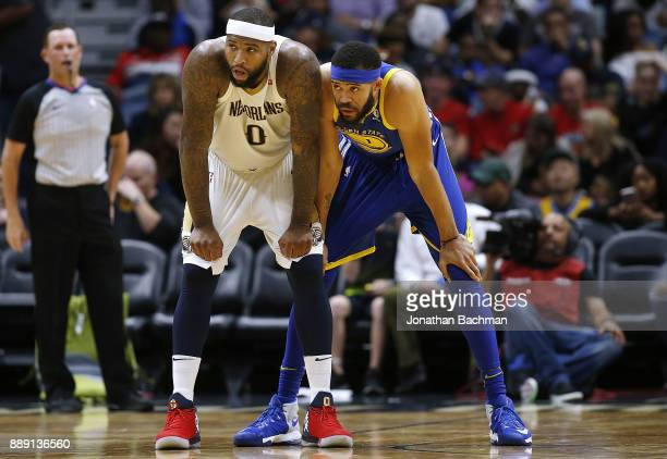 DeMarcus Cousins of the New Orleans Pelicans and JaVale McGee of the Golden State Warriors stand on the court during the second half of a game at the...