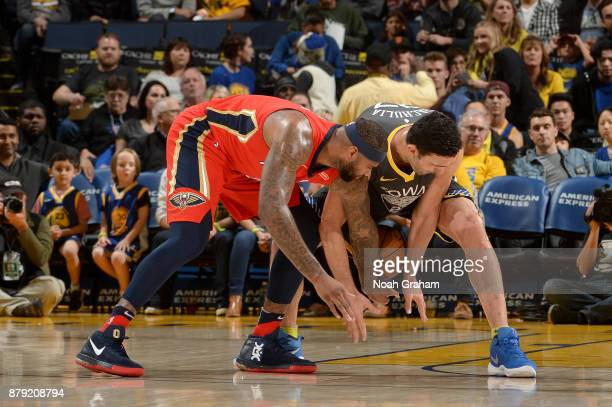DeMarcus Cousins of the New Orleans Pelicans and Zaza Pachulia of the Golden State Warriors battle for possession during the game on November 25 2017...
