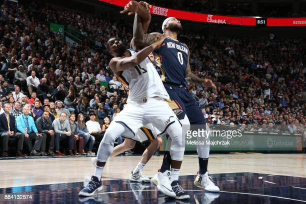 DeMarcus Cousins of the New Orleans Pelicans battles for position against Derrick Favors of the Utah Jazz on December 1 2017 at vivintSmartHome Arena...