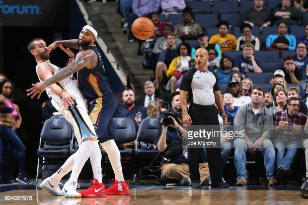 DeMarcus Cousins of the New Orleans Pelicans blocks the ball from Marc Gasol of the Memphis Grizzlies during the game between the two teams on...