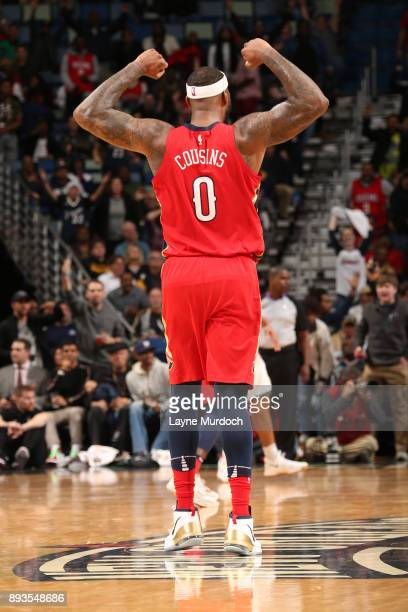 DeMarcus Cousins of the New Orleans Pelicans celebrates and flexes during the game against the Milwaukee Bucks on December 13 2017 at Smoothie King...