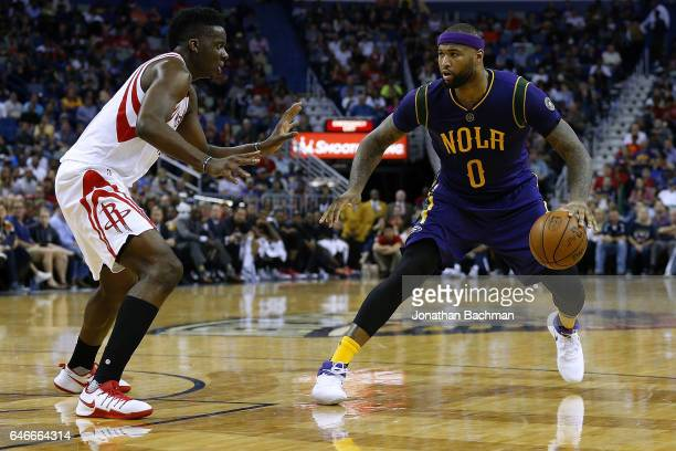 DeMarcus Cousins of the New Orleans Pelicans drives against Clint Capela of the Houston Rockets during a game at the Smoothie King Center on February...
