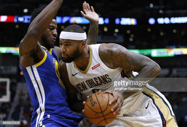 DeMarcus Cousins of the New Orleans Pelicans drives against Jordan Bell of the Golden State Warriors during the first half of a game at the Smoothie...