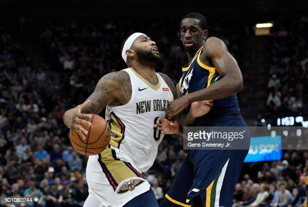 DeMarcus Cousins of the New Orleans Pelicans drives around Ekpe Udoh of the Utah Jazz during the second half of the 10898 win by the Pelicans at...