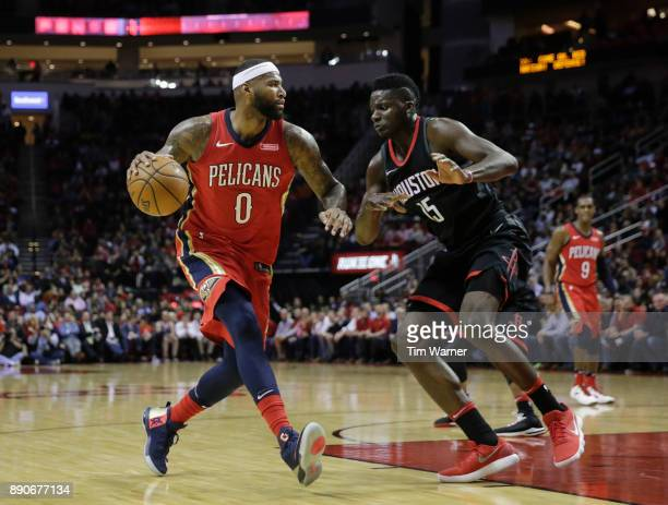 DeMarcus Cousins of the New Orleans Pelicans drives to the basket defended by Clint Capela of the Houston Rockets in the first half at Toyota Center...