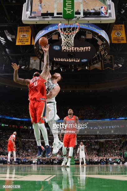 DeMarcus Cousins of the New Orleans Pelicans dunks against Aron Baynes of the Boston Celtics on January 16 2018 at the TD Garden in Boston...