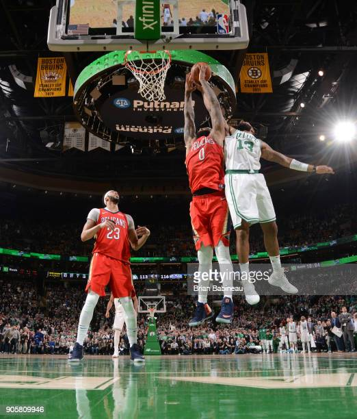 DeMarcus Cousins of the New Orleans Pelicans dunks against Marcus Morris of the Boston Celtics on January 16 2018 at the TD Garden in Boston...