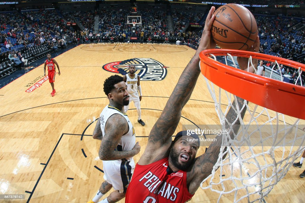 DeMarcus Cousins #0 of the New Orleans Pelicans dunks against the Denver Nuggets on December 6, 2017 at Smoothie King Center in New Orleans, Louisiana.