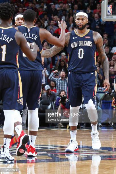 DeMarcus Cousins of the New Orleans Pelicans exchanges handshakes with his team during the game against the Houston Rockets on January 26 2018 at...