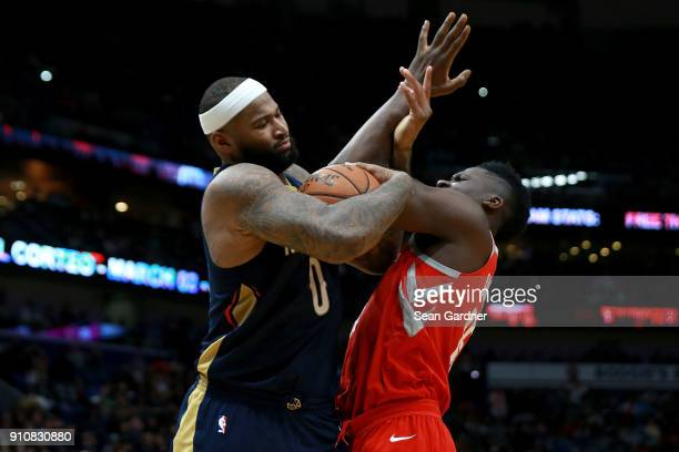 DeMarcus Cousins of the New Orleans Pelicans fights for a loose ball with Clint Capela of the Houston Rockets during the second half at the Smoothie...