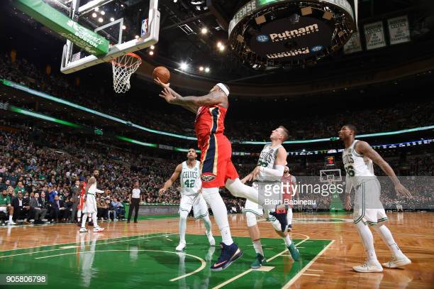 DeMarcus Cousins of the New Orleans Pelicans goes for a lay up against the Boston Celtics on January 16 2018 at the TD Garden in Boston Massachusetts...