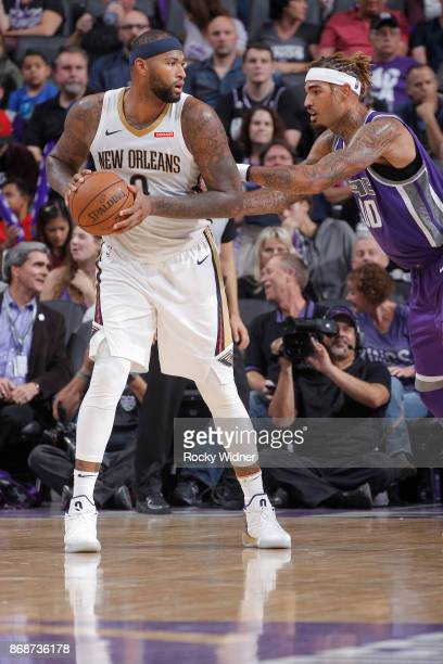 DeMarcus Cousins of the New Orleans Pelicans handles the ball against Willie CauleyStein of the Sacramento Kings on October 26 2017 at Golden 1...