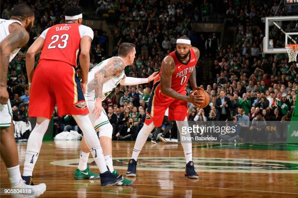 DeMarcus Cousins of the New Orleans Pelicans handles the ball against the Boston Celtics on January 16 2018 at the TD Garden in Boston Massachusetts...