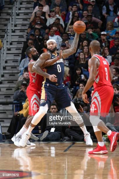 DeMarcus Cousins of the New Orleans Pelicans handles the ball against the Houston Rockets on January 26 2018 at Smoothie King Center in New Orleans...