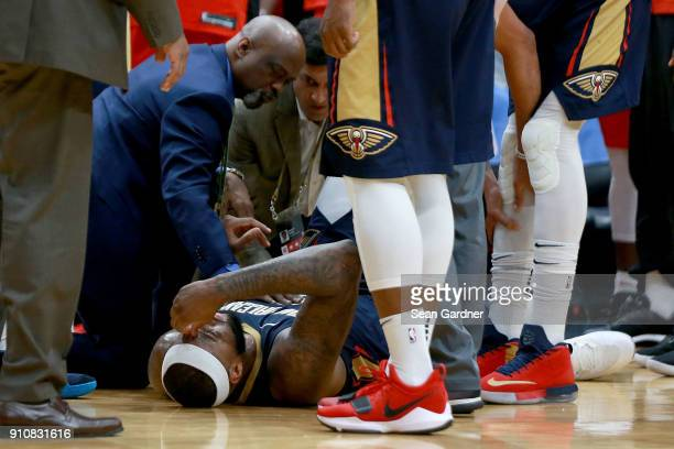 DeMarcus Cousins of the New Orleans Pelicans lies down on the ground after injuring his ankle during the second half of a NBA game against the...