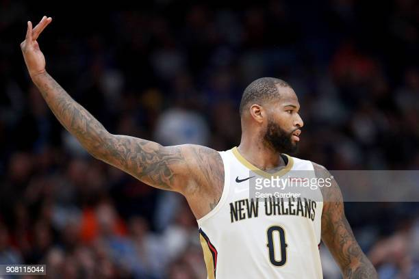 DeMarcus Cousins of the New Orleans Pelicans reacts after assiting on a score during the second half of a NBA game against the Memphis Grizzlies at...