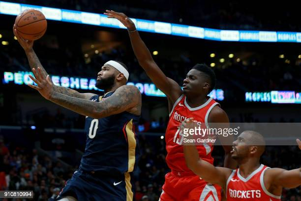 DeMarcus Cousins of the New Orleans Pelicans shoots over Clint Capela of the Houston Rocketsduring the first half at the Smoothie King Center on...