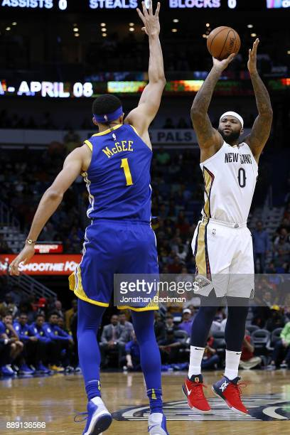 DeMarcus Cousins of the New Orleans Pelicans shoots over JaVale McGee of the Golden State Warriors during the first half of a game at the Smoothie...