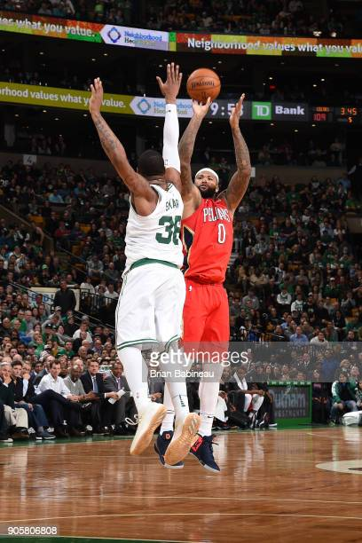 DeMarcus Cousins of the New Orleans Pelicans shoots the ball against the Boston Celtics on January 16 2018 at the TD Garden in Boston Massachusetts...
