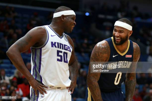 DeMarcus Cousins of the New Orleans Pelicans talks with Zach Randolph of the Sacramento Kings during the first half of a NBA game at the Smoothie...