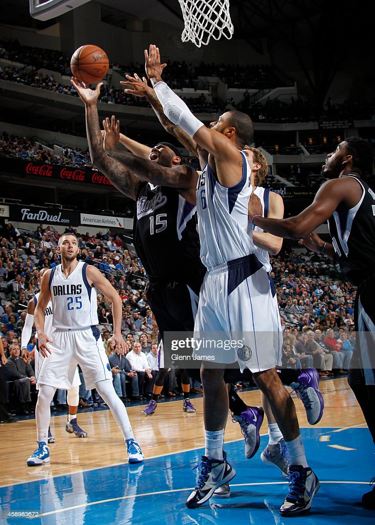 DeMarcus Cousins #15 of the Sacaramento Kings goes up for a shot against the Dallas Mavericks on November 11, 2014 at the American Airlines Center in Dallas, Texas.