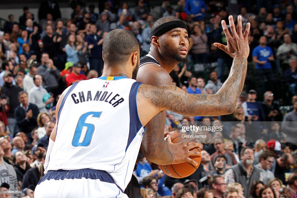 DeMarcus Cousins #15 of the Sacaramento Kings looks to pass against the Dallas Mavericks on November 11, 2014 at the American Airlines Center in Dallas, Texas.