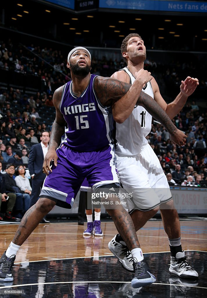 DeMarcus Cousins #15 of the Sacramento Kings boxes out Brook Lopez #11 of the Brooklyn Nets on November 27, 2016 at Barclays Center in Brooklyn, NY.