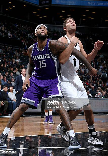 DeMarcus Cousins of the Sacramento Kings boxes out Brook Lopez of the Brooklyn Nets on November 27 2016 at Barclays Center in Brooklyn NY NOTE TO...