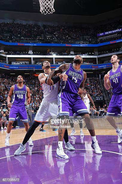 DeMarcus Cousins of the Sacramento Kings boxes out Enes Kanter of the Oklahoma City Thunder on November 23 2016 at Golden 1 Center in Sacramento...