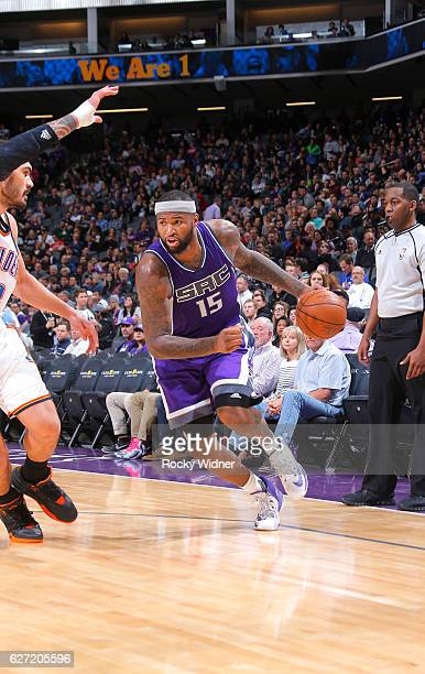DeMarcus Cousins of the Sacramento Kings drives against Steven Adams of the Oklahoma City Thunder on November 23 2016 at Golden 1 Center in...