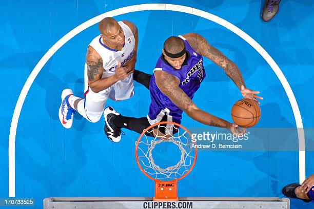 DeMarcus Cousins of the Sacramento Kings drives to the basket against Caron Butler of the Los Angeles Clippers at Staples Center on December 21 2012...