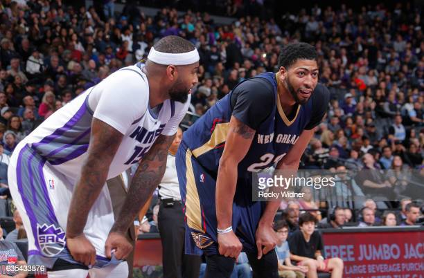 DeMarcus Cousins of the Sacramento Kings faces off against Anthony Davis of the New Orleans Pelicans on February 12 2017 at Golden 1 Center in...