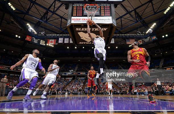 DeMarcus Cousins of the Sacramento Kings goes up for the dunk against Kyrie Irving of the Cleveland Cavaliers on January 14 2013 at Sleep Train Arena...