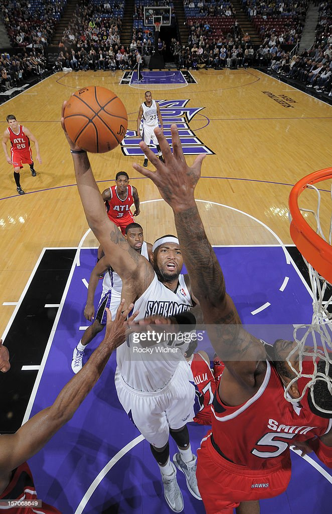 DeMarcus Cousins #15 of the Sacramento Kings goes up for the shot against Josh Smith #5 of the Atlanta Hawks on November 16, 2012 at Sleep Train Arena in Sacramento, California.
