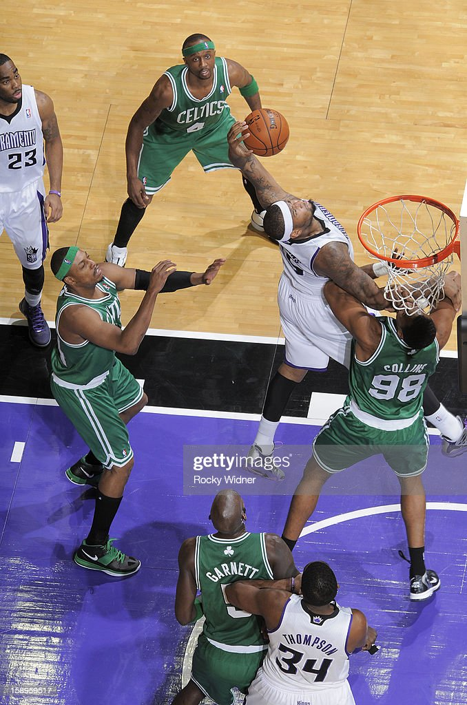 DeMarcus Cousins #15 of the Sacramento Kings grabs the rebound against Jason Collins #98 of the Boston Celtics on December 30, 2012 at Sleep Train Arena in Sacramento, California.