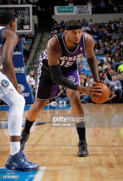 DeMarcus Cousins of the Sacramento Kings handles the ball against Bernard James of the Dallas Mavericks on February 13 2013 at the American Airlines...
