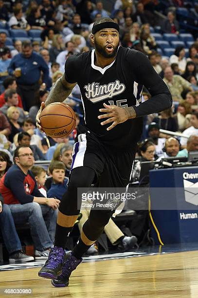 DeMarcus Cousins of the Sacramento Kings handles the ball during a game against the New Orleans Pelicans at the Smoothie King Center on March 27 2015...