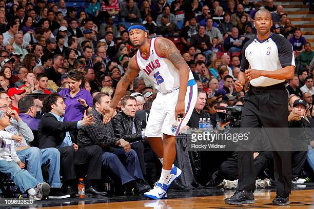 DeMarcus Cousins of the Sacramento Kings highfives owners Joe and Gavin Maloof against the Los Angeles Clippers on February 28 2011 at ARCO Arena in...