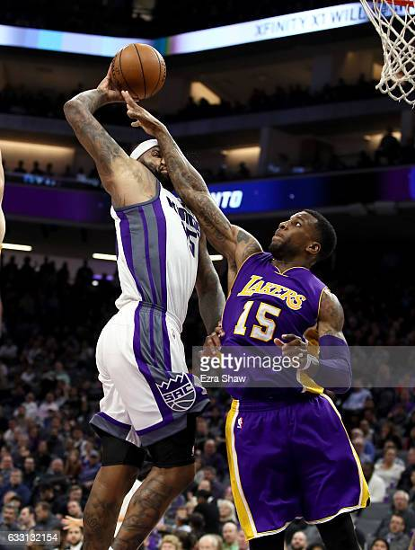 DeMarcus Cousins of the Sacramento Kings is hit in the face as he goes up for a shot on Thomas Robinson of the Los Angeles Lakers at Golden 1 Center...