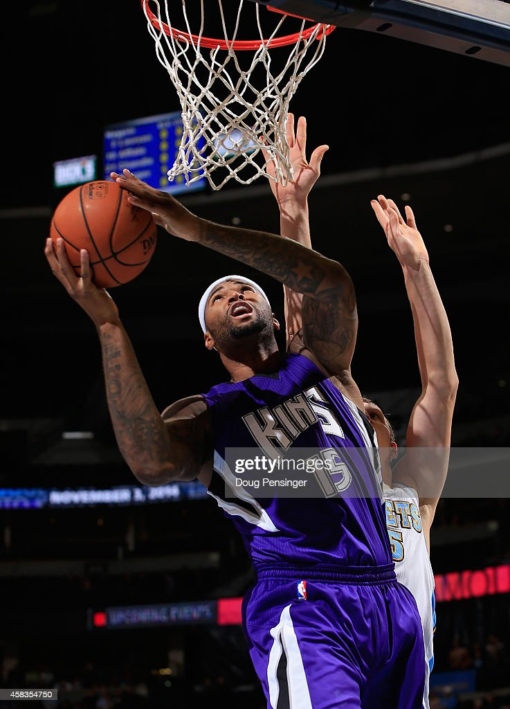 DeMarcus Cousins #15 of the Sacramento Kings lays in a shot against Timofey Mozgov #25 of the Denver Nuggets at Pepsi Center on November 3, 2014 in Denver, Colorado.