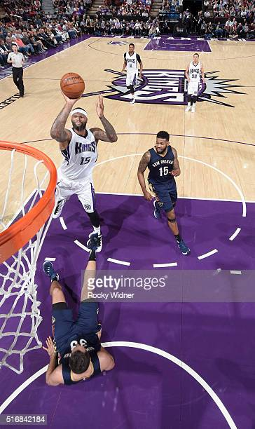 DeMarcus Cousins of the Sacramento Kings puts up a shot against Ryan Anderson of the New Orleans Pelicans on March 16 2016 at Sleep Train Arena in...